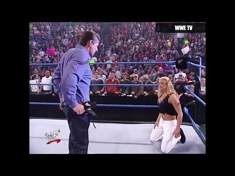 Trish Stratus  was saved by the Rock from Vince McMahon