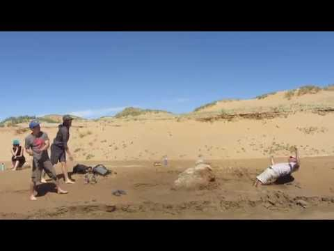 quicksand mud - Having some fun in a shallow quicksand pool in the Gobi desert.