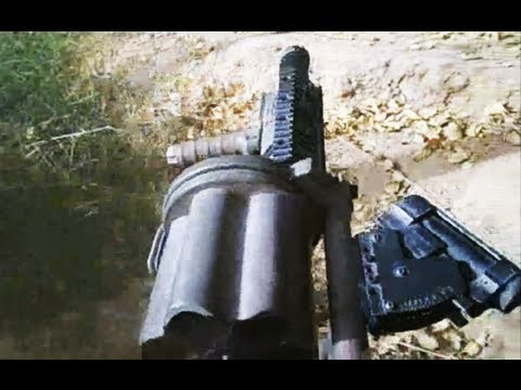 firing - U.S. Marines battling Taliban in Marjah, Helmand Province, Afghanistan, employ the M-32 semi automatic grenade launcher to suppress enemy forces firing from ...
