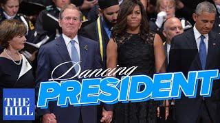 George W. Bush dances during the Dallas Memorial