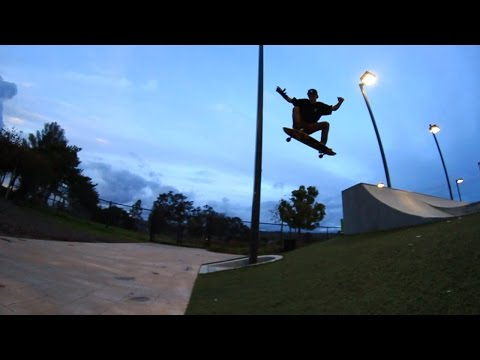 SKATEBOARDER OLLIES MASSIVE GAP ON A LONGBOARD!