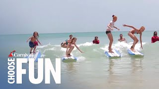 Learn how to surf with the experts at a local San Juan sandy beach and enjoy a great beach day.