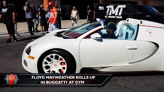 Floyd Mayweather rolls in a fleet of Bugatti's to the gym