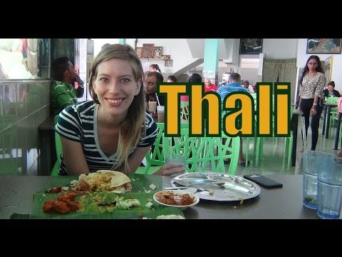 Eating a Banana Leaf Thali Set for lunch in Malacca, Malaysia video