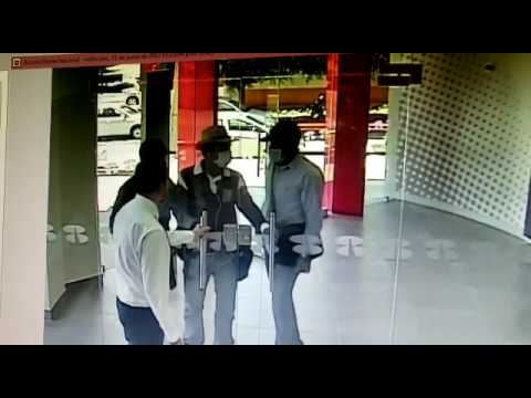 3 guys try to rob a bank, employee locks the door right in their face so they just turn around