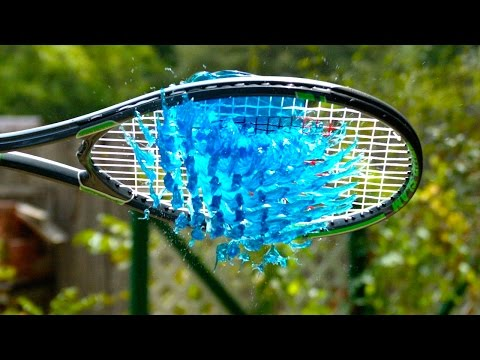 People hitting jelly with tennis rackets in super slow