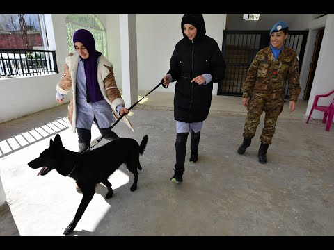 Employing Dogs, UNIFIL Peacekeepers Help Children with Learning Disabilities