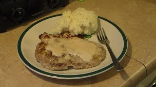 Gravy baked pork chops, savory and delicious.