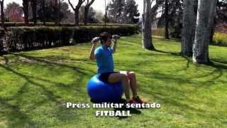 Press militar sentado  sobre fitball con mancuernas