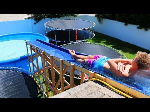 GIANT Backyard Water Slide in our Trampoline Water Park!! (видео)