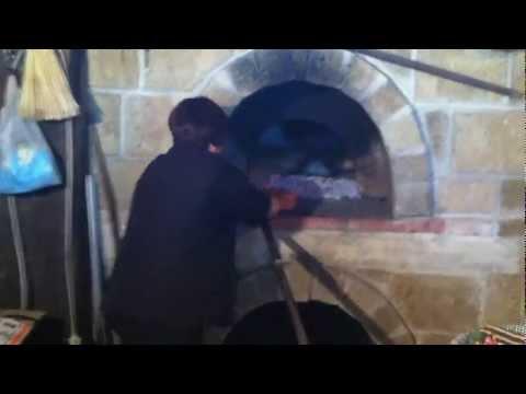 Pane fatto in casa cotto nel forno a legna tour eno-gastronomico La Bussola Hotel Capo Vaticano