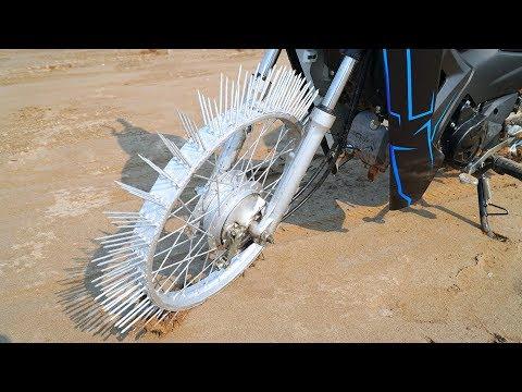 NTN - Thử Đi Xe Máy Bánh Gắn Đinh (Ride motorbike on Nails) - Thời lượng: 10 phút.
