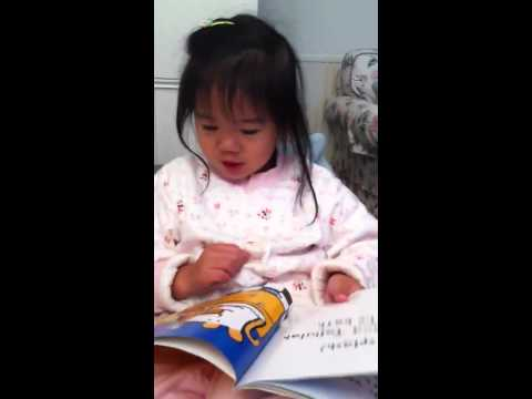 Angela reads Maisy's story book