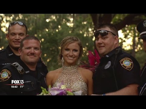 Officers escort fallen colleague's daughter to prom