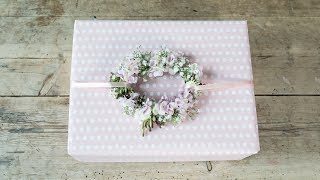 """With just a bit of wire and a few flowers from your garden, you can wrap a wonderful present. Take a look at this video and discover how Anna decorates presents with summer flowers. Find more creative ideas here: http://sostrenegrene.com/diy-corner/ Find the products from the video in your local Søstrene Grene shop.Remember to press the """"thumbs up"""" button and tell all your friends about this simple, but creative way of making gifts for your friends. You can also subscribe to our channel for notifications on Anna's DIY videos on fun craft projects. On our YouTube channel, you can find creative inspiration and tutorials on DIY projects, styling, painting and even cooking. All our videos aspire to encourage playfulness and creativity for all ages, kids and adults alike.Best regards,SØSTRENE GRENEFind further inspiration on our other social media channels:https://instagram.com/sostrenegrenehttps://facebook.com/sostrenegrenehttps://youtube.com/sostrenegrenehttp://pinterest.com/sostrenegrenesVideo timeline:Materials: 0:01Final product: 1:10"""