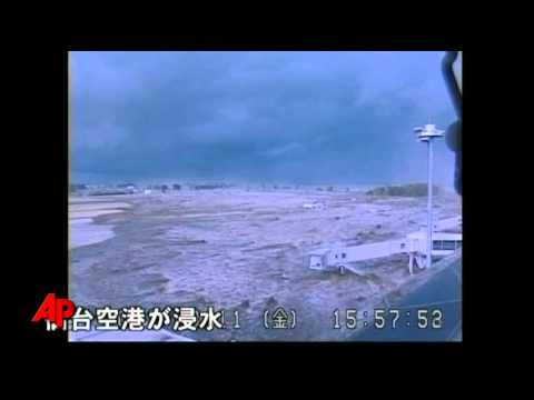 Raw Video: Tsunami Wave Strikes Japan Airport