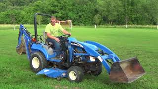 2007 NEW HOLLAND TZ18DA COMPACT TRACTOR WITH LOADER, MOWER, BACKHOE