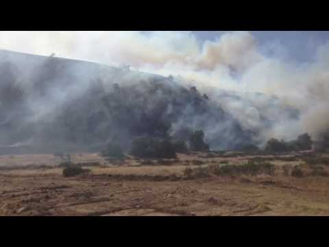 BANNING: Fire crews work to contain Summit fire
