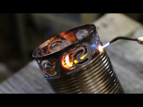 I'm a metal worker and I make candle lights out of old soup cans [0:25]