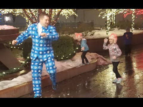 PLAYING TAG IN A CHRISTMAS SUIT