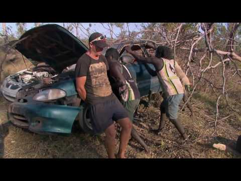 Aboriginal Australians resurrect a wrecked Hyundai in the bush. The series is called 'Black As'