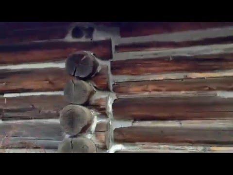 Historical Gangloff Park in La Grande, Oregon; old log house in the hills