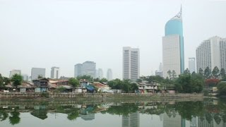 Two residents of Indonesia's capital Jakarta live almost side by side, yet they are separated by income inequality. Both explain...