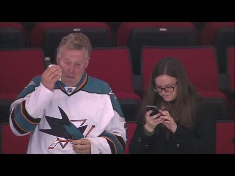 Father overcome with pride watching his goal tending son finish his NHL debut game with a shut out.