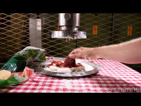 Making pizza with hydraulic press