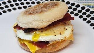 Breakfast sandwich recipe. I made this breakfast sandwich in the toaster oven. I used turkey bacon, Canadian bacon, an egg, cheese, and an English muffin for ...