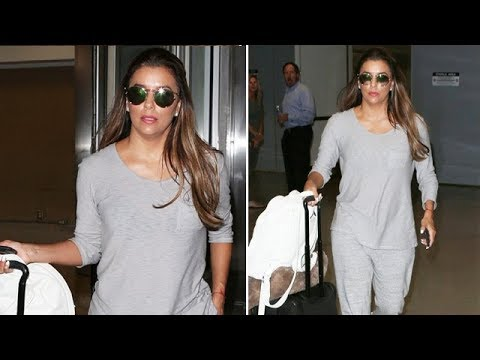 Comfy Flier Eva Longoria Touches Down At LAX Sporting Grey Sweats