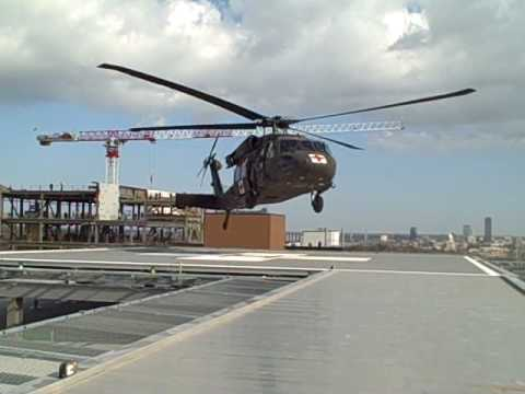 helipad - With a roar, the Blackhawk helicopter approached the helipad and deftly maneuvered between antennas and a construction crane to alight atop the new hospital ...