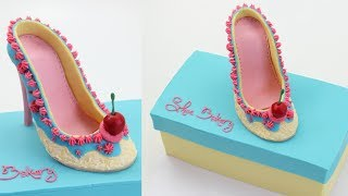 "SUBSCRIBE HERE ~ http://bit.ly/cakestyleCOOL CAKES ~ http://bit.ly/coolcakestyleHi everyone! Today I made a ""Shoe Bakery"" shoe that you can really eat! I had so much fun making this one, it's been on my list for a while. What cake would you like to see me make next?Follow UsWEBSITEhttp://cake.style/FACEBOOKhttps://www.facebook.com/cakestyletvTWITTERhttps://twitter.com/Cake_StyleINSTAGRAMhttp://instagram.com/cakestyle_PINTERESThttp://www.pinterest.com/cakestyletv/Materials•  10"" square cake at 2"" height•  800g Sweet Buttercream - http://cake.style/2016/03/01/sweet-buttercream/ with cocoa added• 1 batch Modelling chocolate - http://cake.style/2016/04/30/modelling-chocolate/• Gel food colors used   - Blue - Americolor Electric Blue   - Yellow - Americolor Lemon Yellow and Wilton Ivory   - Pink - Sugarflair Ruby and Americolor Deep Pink   - Tan - Americolor Warm Brown, Wilton Ivory and a touch of Americolor Super Black   - Red - Americolor Super Red and Sugarflair Ruby   - Green - Americolor Forest Green and Americolor Leaf Green• 14"" square cake board• Water• Small spatula - http://amzn.to/1Vtq19X• Turntable - Ikea• Bread Knife - http://amzn.to/1qXhtew• Small rolling pin - http://amzn.to/1Slg8Ku• Large rolling pin - http://amzn.to/1YARC6x• Cornflour/ Cornstarch• Exacto knife - http://amzn.to/22BXAFk• Scraper - http://amzn.to/1Tc5ocs• Pizza cutter - http://amzn.to/1r5FyA4• Paint brush• Toothpick• Parchment paper/ Baking paper• Shoe mold set• Royal icing   -  Ivory - Wilton Ivory   -Pink - Sugarflair Ruby and Americolor Deep PinkMusic - Second songLife of Riley by Kevin MacLeod is licensed under a Creative Commons Attribution license (https://creativecommons.org/licenses/by/4.0/)Source: http://incompetech.com/music/royalty-free/index.html?isrc=USUAN1400054Third songItalian Afternoon by Twin Musicom is licensed under a Creative Commons Attribution license (https://creativecommons.org/licenses/by/4.0/)Artist: http://www.twinmusicom.org/"