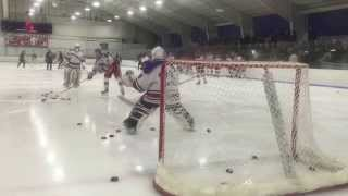 T Harris warming up in net with Tewksbury Redmen Varsity team