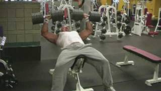 Stan Efferding incline presses 210 pound dumbells for 9 reps
