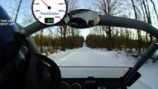 2. Ski Doo Elite w/passenger showing some speed on trail