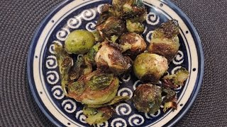 How to Make Roasted Brussels Sprouts with Bacon - Episode 104IngredientsBrussels Sprouts (1/4 lb (100g) per person) - 2 lbs = 1 kiloBacon - 1 lb. = 400gKosher Salt - 1tFresh ground pepper to tasteRed pepper flakes to tasteOlive Oil - 2T +Wash and trim sprouts.Remove spotted or yellow leaves.Cut in 1/2 lengthwiseChop bacon.Add sprouts, bacon, seasonings in bowl and mix evenly.Spread in single layer on sheetpan.Roast at 425F = 220C = gas mark 7 for approximately 30-45 minutes till sprouts begin to carmelize.Visit our websitewww.KitchenSimple.TV