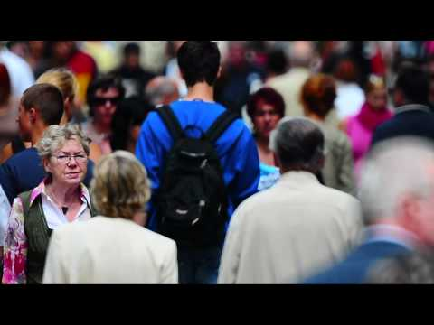 crowd - The mass of the people on the street walking. F1000mm. HD Video.