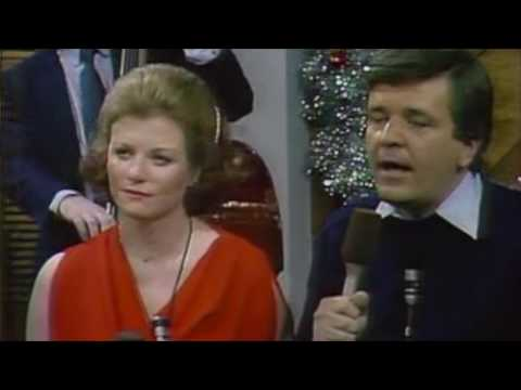 Natalie Jacobson, Chet Curtis, John Willis and Eileen wish you a Merry Christmas in song!