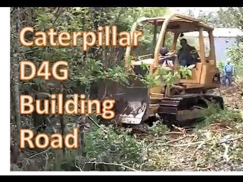 Caterpillar  D4G building road.