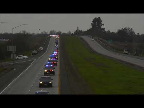 See Natalie Corona procession stretch and flash far down Highway 113