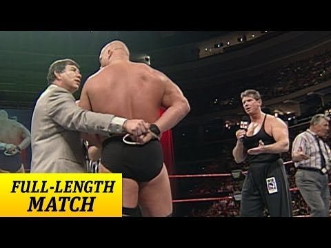 """Stone Cold"" Steve Austin battles Mr. McMahon with one arm tied behind his back"