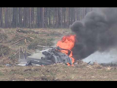 Moment helicopter crashes at airshow in Russia