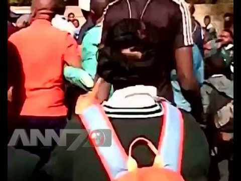 Motorist attacks police officer as crowd cheers