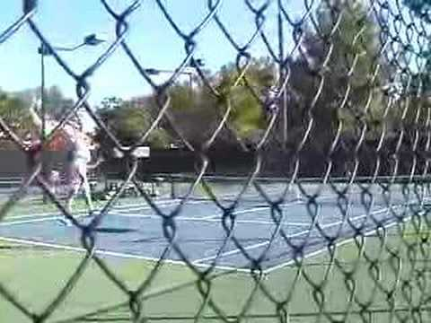tennis jump serve and two-handled racket