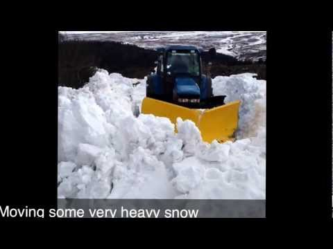 Tractor v plow in deep snow