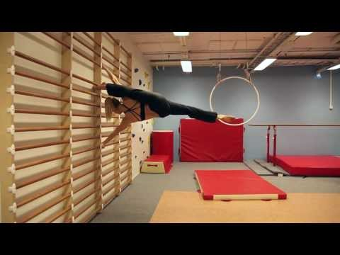 Hardcore - World pole dance champion Oona Kivelä demonstrating strength and flexibility moves on stall bars, parallel bars, floor and pole. Like https://www.facebook.co...