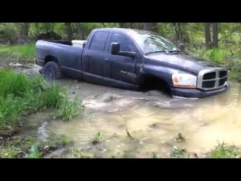 Cummins diesel rescued from mud by Powerstroke