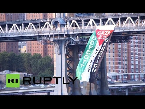 Bridge - Hundreds of protesters flooded the Manhattan Bridge in New York City on Wednesday, carrying signs and chanting in support of Palestinians as violence continues to rage in Gaza. READ MORE: http://on...