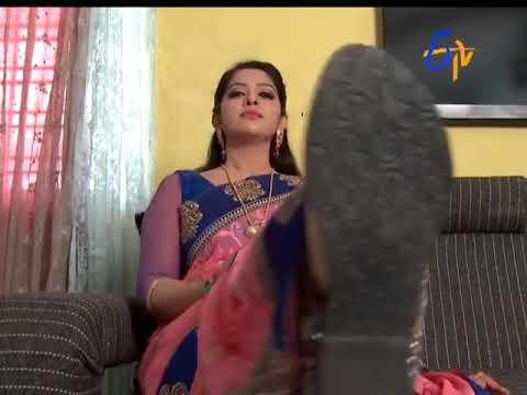 Jyothika feet on table